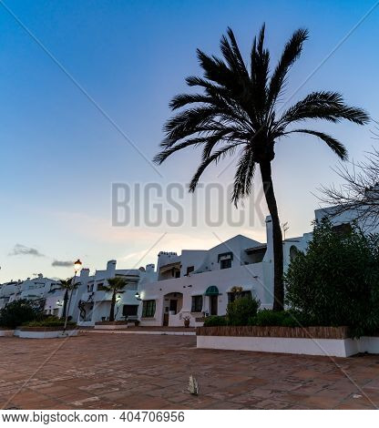Typical White Andalusian Buildings In La Duquesa At Sunset