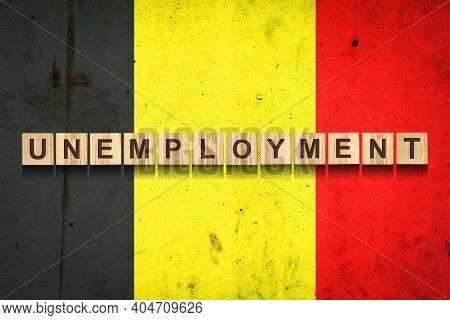 Unemployment. The Inscription On Wooden Blocks On The Background Of The Belgium Flag. Unemployment G