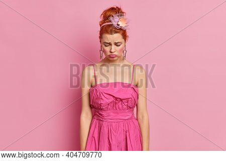 Upset Dejected Redhead Woman Looks Sadly Down Has Spoiled Mood Wears Stylish Dress Comes On Party Fe