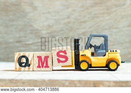 Toy Forklift Hold Letter Block S To Complete Word Qms (abbreviation Of Quality Management System) On