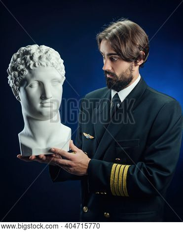 The Pilot Of The Plane Is A Man With A Beard With A White Plaster Head