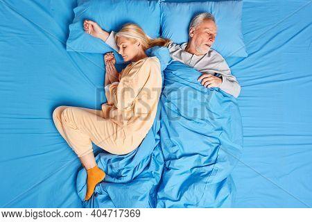 Sleeping Married Family Couple Have Deep Sleep At Night Enjoys Serene Atmosphere Dressed In Nightwea