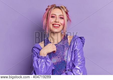Glad Blonde Beautiful European Woman With Bright Vivid Makeup Dressed In Fashionable Clothes Poses A