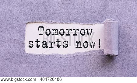 The Text Tomorrow Starts Now Appears On Torn Lilac Paper Against A White Background.