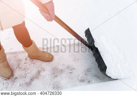 Service Cleaning Snow Winter With Shovel After Snowstorm. Snow Removal In Wintertime. Working Cleani