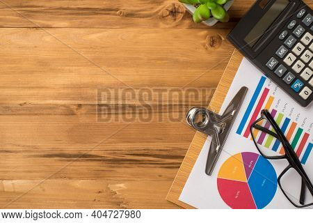 Top Above Overhead Flatlay View Photo Of Calculator Wooden Clipboard With Colorful Diagram And Eyewe
