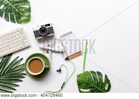 Top View Of Traveler Accessories And Green Cup Coffee  With Tourism Backpack And Visiting For Planni