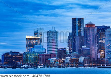 Dusk Photo Of Boston Downtown View From Main Channel Over Embarkment