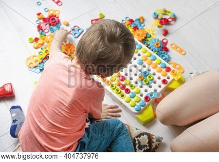 Preschool Child Development Background With Baby Playing With Educational Game Constructor