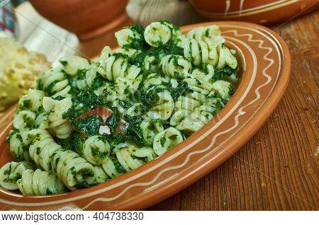 Fusilli Col Pesto Alla Genovese -  Classic Ligurian Dish, With Basil Pesto Gently Coating Al Dente P