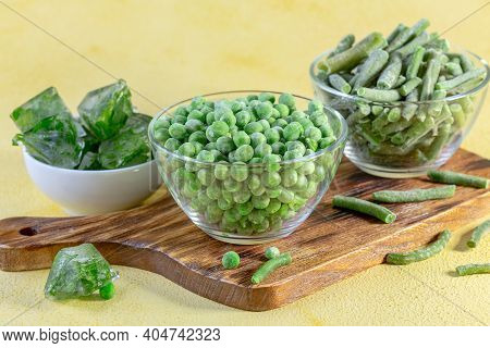 Shock-frozen Legumes And Ice Cubes With Parsley.
