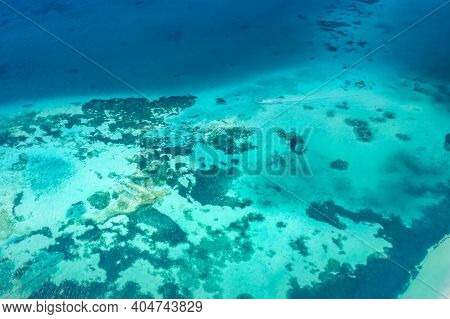 Beautiful View Of The Turquoise Sea. Deep Sea And Shallow Lagoon With Corals. Top View Of Beautiful