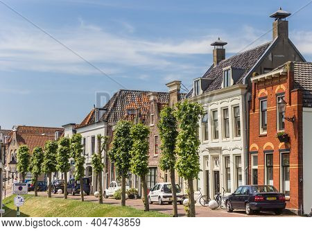 Haastrecht, Netherlands - May 21, 2020: Old Houses On The Dike In The Center Of Haastrecht, Netherla
