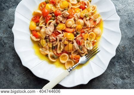 Close Up Of A Plate Of Tuna Orecchiette Pasta With Cherry Tomatoes