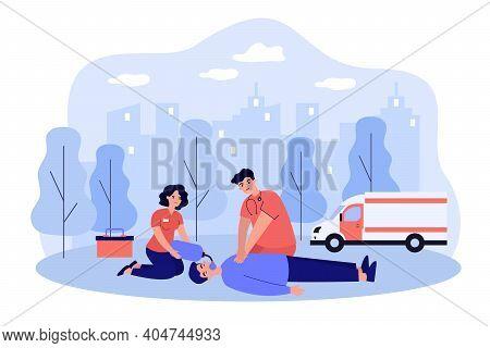 Paramedics Resuscitating Unconscious Person. Doctor And Assistant Applying Cardiopulmonary Resuscita