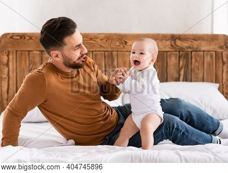 Young Daddy And Little Toddler Having Fun Bonding And Playing Spending Time Together At Home, Sittin