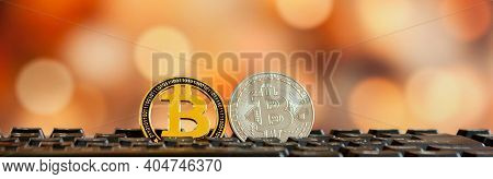 Bitcoin Currency On Keyboard Computer On Bokee Background.virtual Cryptocurrency Concept.
