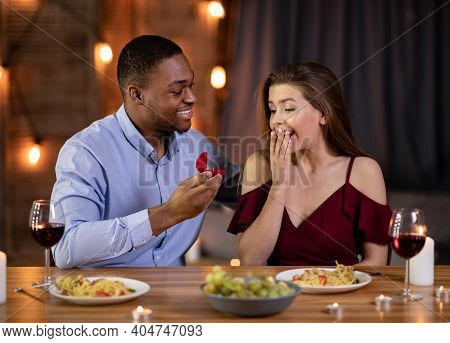Marriage Proposal. Romantic Black Boyfriend Proposing Girlfriend To Marry Him On Dinner Date In Rest