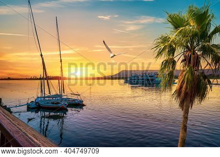 Nile River And Boats At Sunset In Luxor
