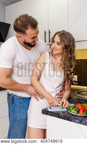 Romantic Happy Couple Hugging And Having Breakfast Table On Weekend Morning. Young Couple At Home In