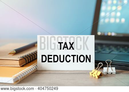 Desktop With Documents, Calculator And Notebook. On A Blockboard Inscription Tax Deduction