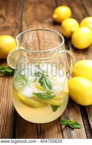 Natural Lemonade With Mint And Fresh Fruits On Wooden Table. Summer Refreshing Drink