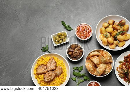 Buffet Service. Flat Lay Composition With Many  Different Dishes On Grey Table, Space For Text