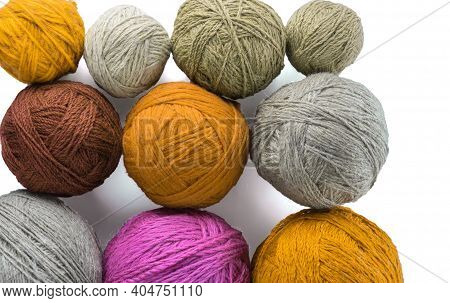 Skeins Of Wool Yarn In Threads For Knitting Clothes. The Texture Of The Wool Yarn.