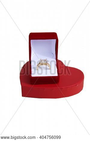 Engagement Ring. Wedding Ring with a Red Valentines Day Heart. Engagement Ring in a Red Ring Box with a Red Velvet Heart. Isolated on white. Room for text. Happy Valentines Day.