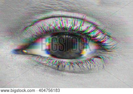 Close up shot of woman's eye with a glitch filter distorting the photo