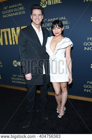 LOS ANGELES - JAN 05:  Actor Jim Carrey and Actress Ginger Gonzaga arrives for Showtime Golden Globe Nominee Celebration Premiere on January 05, 2019 in West Hollywood, CA