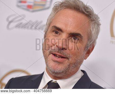 LOS ANGELES - JAN 19:  Director Alfonso Cuaron arrives for the 30th Annual Producers Guild Awards on January 19, 2019 in Beverly Hills, CA