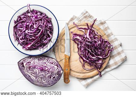 Sliced fresh red cabbage on cutting board.