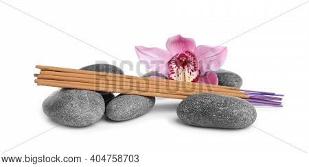 Aromatic Incense Sticks, Spa Stones And Orchid Flower On White Background