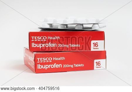 London / Uk - January 23rd 2021 - Ibuprofen Packets From Tesco Supermarket, Stacked Against A White