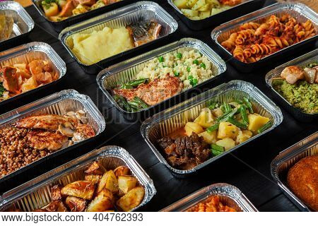 Business Lunch In Eco Plastic Container Ready For Delivery.top View. Office Lunch Boxes With Food Re