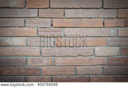 Close-up Of Antique Brick Block Wall Textured Pattern With Vignetted For Backgrounds And Text Design