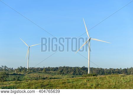 Wind Turbines Park For Make The Electric Power From Wind In Sunset Time