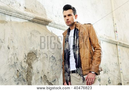 Young Handsome Man, Model Of Fashion, With Toupee In Urban Background