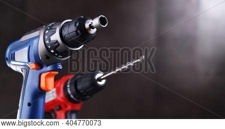 A Screw Gun And A Pistol-grip Cordless Drill