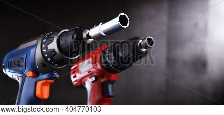 A Screw Gun And A Pistol-grip Cordless Drill.