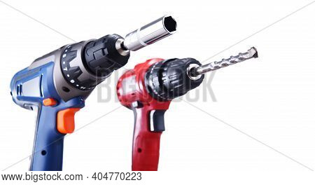A Screw Gun And A Pistol-grip Cordless Drill Isolated On White Background