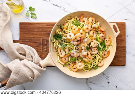 Shrimp And Zucchini Noodles Or Zoodles Pasta With Parmesan And Chili Flakes Cooked In A Cast Iron Pa