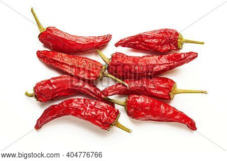 Red Pepper Top View. Dry Peppers Are Grouped On A White Background. Hot Chili Peppers. Spices For Co