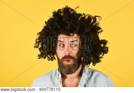 Surprised Man In Curly Wig. Surprised Bearded Man. Portrait Of Surprised Man. Isolated. Wig. Colorfu