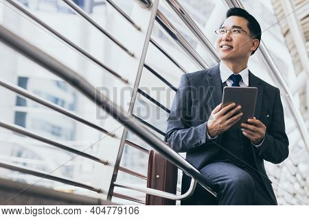 Handsome Asian Businessman Holding Digital Tablet, Wear Suit And Eyeglasses. Leadership Executive Bu