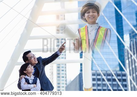 Business Father Showing Heritage Of Building To His Son That Young Boy Will Be Heir. Little Child Is