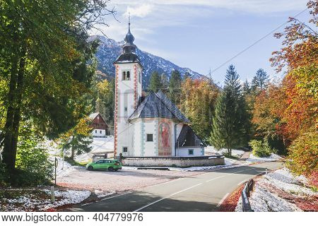 Triglav National Park, Slovenia, October 2020: Church Of The Holy Spirit Between The Alpine Range An