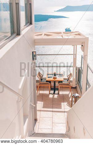 Top Destination Of Europe, Santorini, Greece. Bright Sun Flooding A Classic Greek Island Scene Of Wh