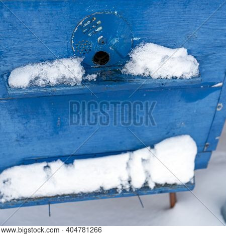 A Pair Of Snow Covered Bee Hives. Apiary In Wintertime. Beehives Covered With Snow In Wintertime. Be